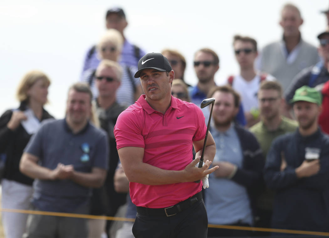 Brooks Koepka of the US watches his hshot from the 5th tee during the third round of the British Open Golf Championship in Carnoustie, Scotland, Saturday July 21, 2018. (AP Photo/Jon Super)