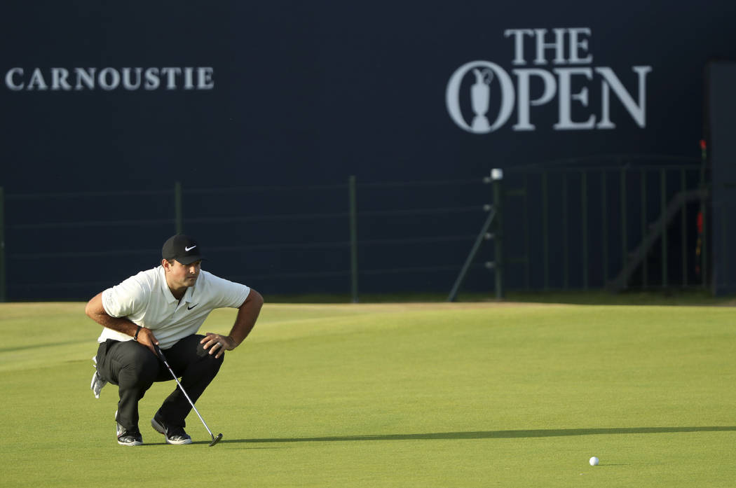 Patrick Reed of the US lines up a putt on the 18th green during the second round of the British Open Golf Championship in Carnoustie, Scotland, Friday July 20, 2018. (AP Photo/Peter Morrison)