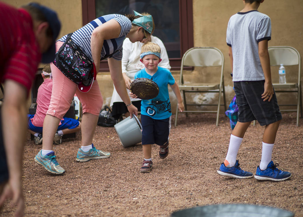"Four-year-old David competes in the buffalo chip toss during the ""Pioneer Day"" event at the Old Las Vegas Mormon Fort State Historical Park in Las Vegas on Saturday, July 21, 2018. Chase ..."