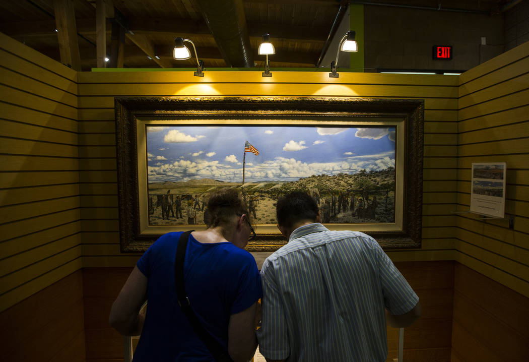 "Joy Covert and Winn Tupaz look at an exhibition display during the ""Pioneer Day"" event at the Old Las Vegas Mormon Fort State Historical Park in Las Vegas on Saturday, July 21, 2018. Cha ..."