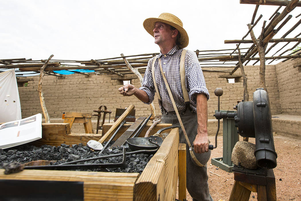 "Scott Elkins talks about blacksmithing during the ""Pioneer Day"" event at the Old Las Vegas Mormon Fort State Historical Park in Las Vegas on Saturday, July 21, 2018. Chase Stevens Las Ve ..."