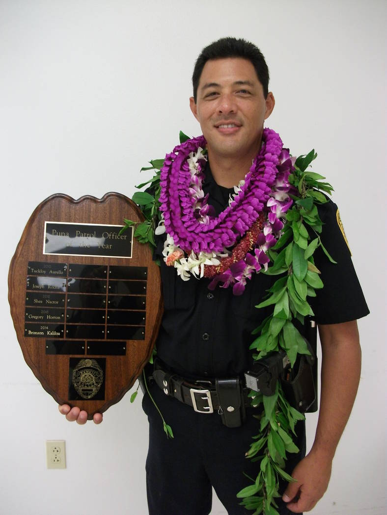 This undated photo provided by the Hawaii County Police Department shows Officer Bronson Kaliloa. A manhunt is underway for a suspect wanted for fatally shooting Kaliloa during a traffic stop on H ...