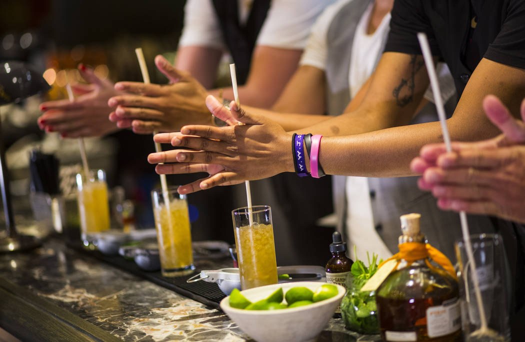 Las Vegas Aces players make a Summer Swizzle cocktail with the help of mixologist Tony Abou-Ganim at Libertine Social in the Mandalay Bay in Las Vegas on Saturday, July 21, 2018. Chase Stevens Las ...