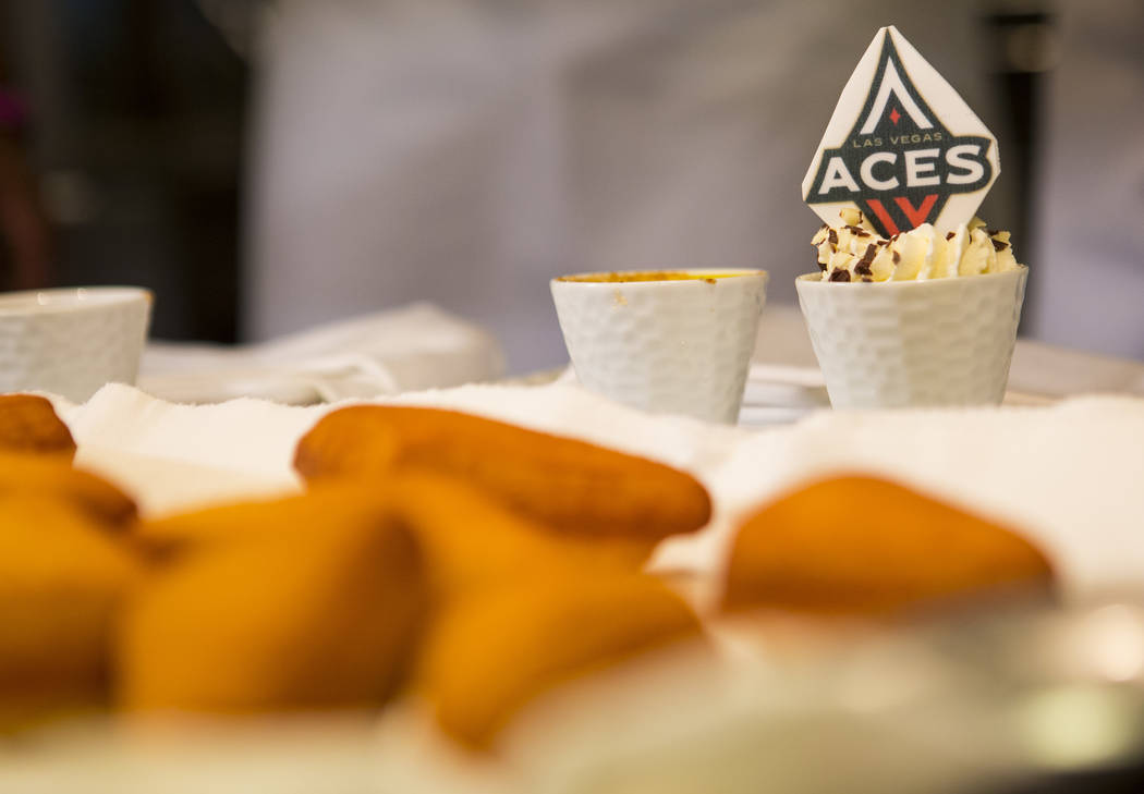 Las Vegas Aces players make beignets with the help of Monica Delgadillo, pastry chef at Stripsteak, not pictured, in the Mandalay Bay in Las Vegas on Saturday, July 21, 2018. Chase Stevens Las Veg ...