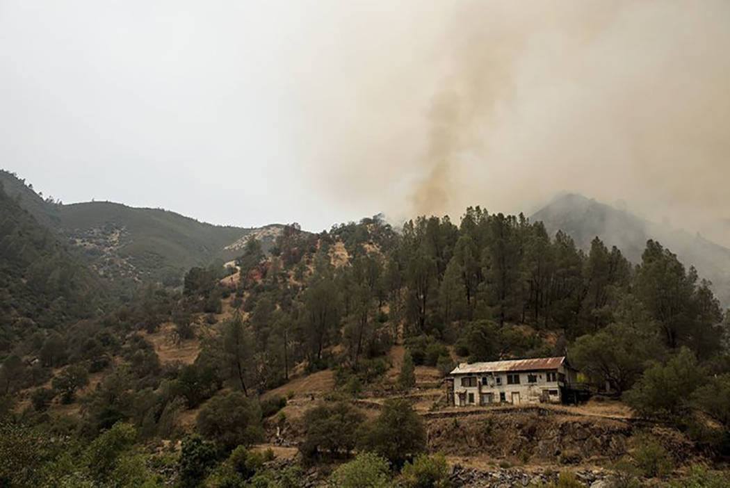 The Ferguson fire continues to burn on the north side of Highway 140 and the Merced River in Mariposa County, Calif., Saturday, July 21, 2018. (Andrew Kuhn/The Merced Sun-Star via AP)