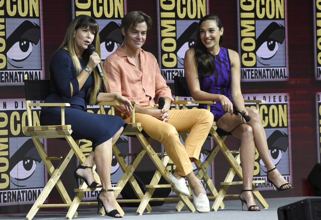 "Patty Jenkins, from left, Chris Pine and Gal Gadot speak at the Warner Bros. Theatrical panel for ""Wonder Woman 1984"" on day three of Comic-Con International on Saturday, July 21, 2018, ..."