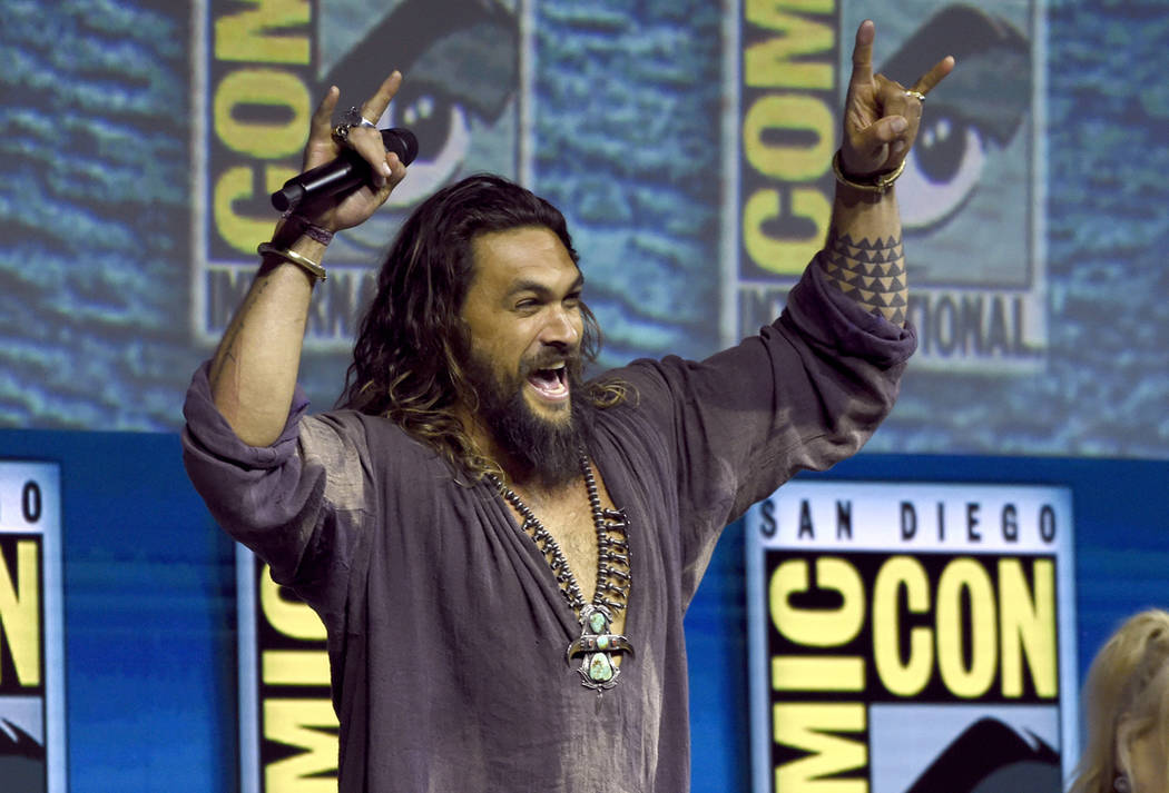 "Jason Momoa greets the crowd at the Warner Bros. Theatrical panel for ""Aquaman"" on day three of Comic-Con International on Saturday, July 21, 2018, in San Diego. (Photo by Chris Pizzello ..."