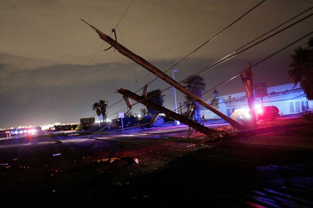Downed power lines are seen on Boulder Highway between Russell and Sunset on Thursday, July 19, 2018, in Henderson. (Chitose Suzuki/Las Vegas Review-Journal @chitosephoto)