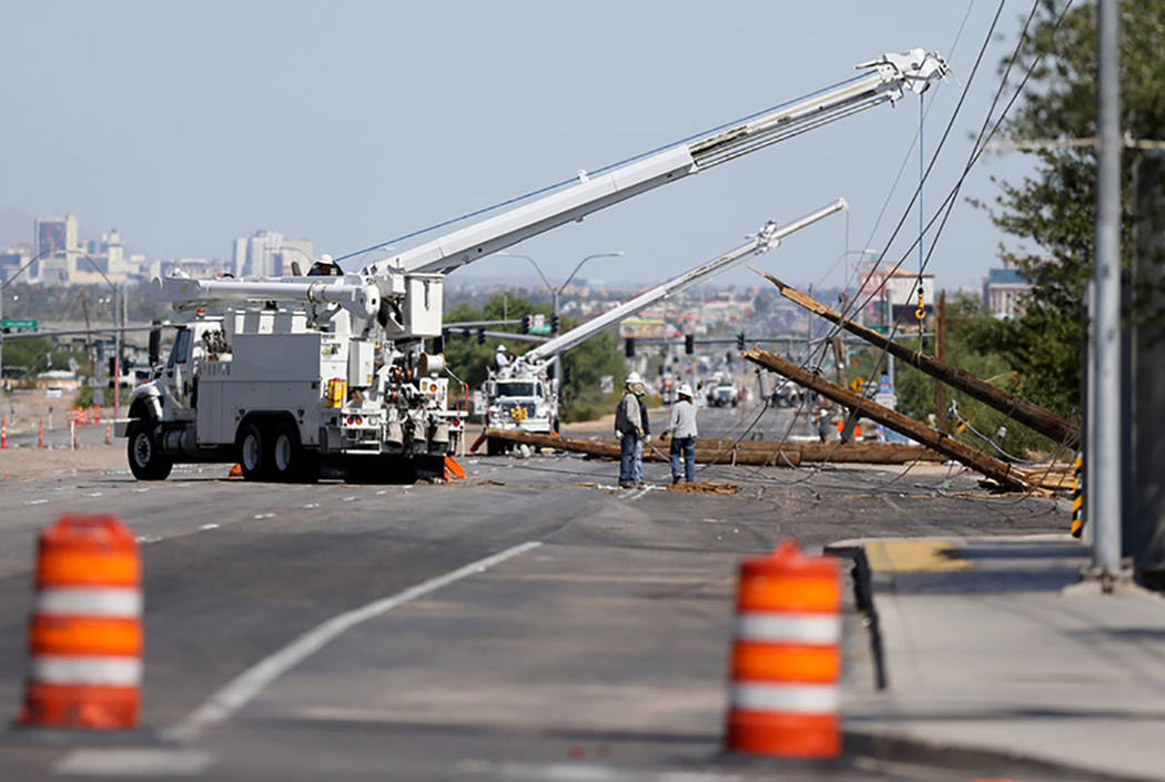 Crews repair fallen power lines on Boulder Highway at Sunset Road Friday, July 20, 2018, after a late night thunderstorm brought down power lines between Sunset and Russell roads. K.M. Cannon Las ...