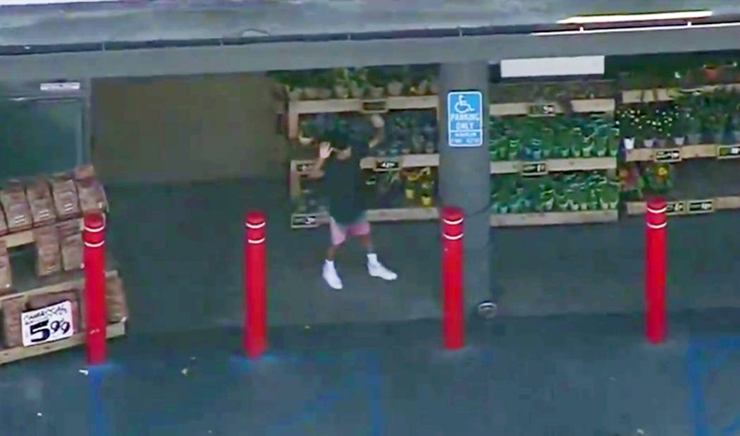 In this image from video provided by KNBC-TV, a man with his hands up walks towards police from a Trader Joe's supermarket in the Silver Lake district of Los Angeles Saturday, July 21, 2018. (KNB ...