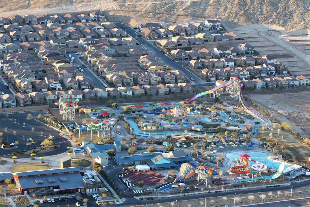 Southwest Las Vegas homes and Wet 'n' Wild water park are seen from a hot air balloon piloted by Daniel Liberti of Rainbow Ryders during an early morning flight Wednesday, Jan. 24, 2018. K.M. Cann ...