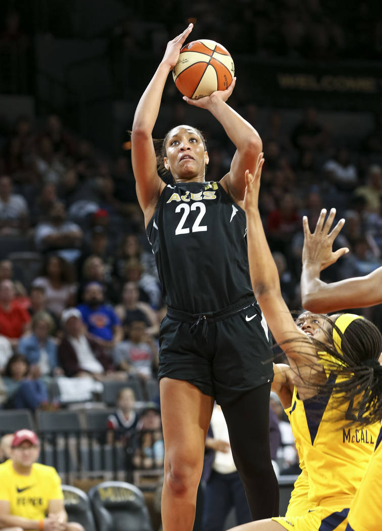 Las Vegas Aces center A'ja Wilson (22) shoots against Indiana Fever defenders during the second half of a WNBA basketball game at the Mandalay Bay Events Center in Las Vegas on Sunday, July 22, 20 ...