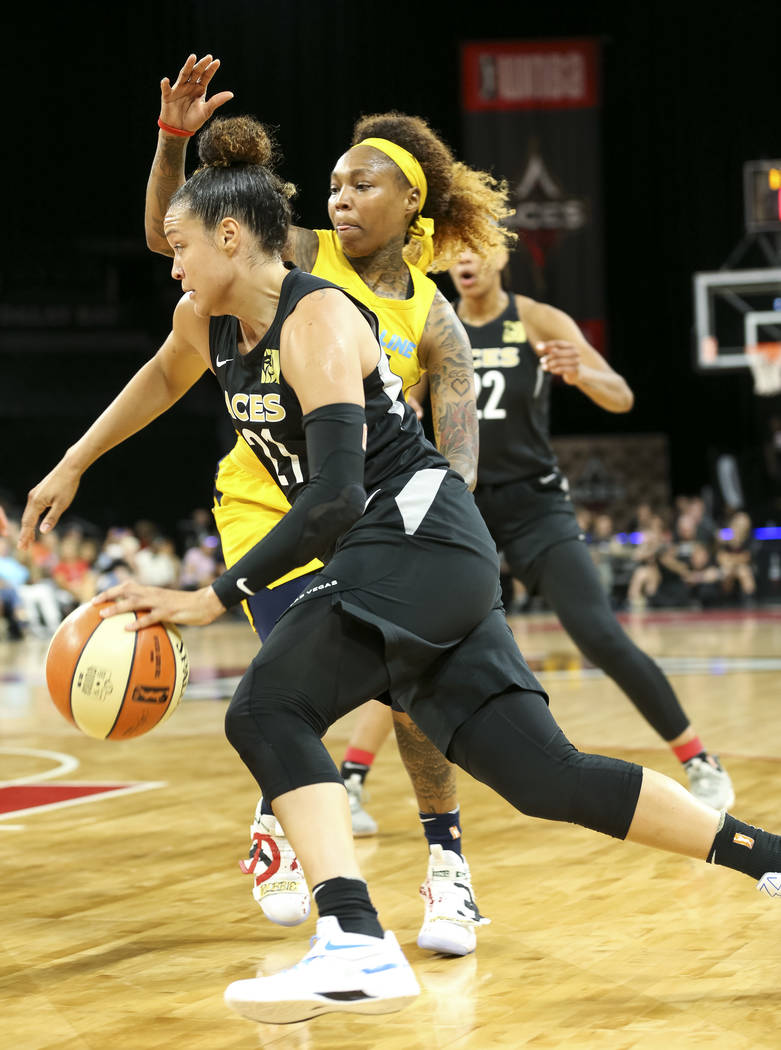 Las Vegas Aces guard Kayla McBride (21) drives the ball past Indiana Fever guard Cappie Pondexter (25) during the first half of a WNBA basketball game at the Mandalay Bay Events Center in Las Vega ...
