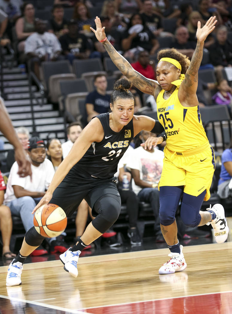 Las Vegas Aces guard Kayla McBride (21) drives the ball against Indiana Fever guard Cappie Pondexter (25) during the first half of a WNBA basketball game at the Mandalay Bay Events Center in Las V ...