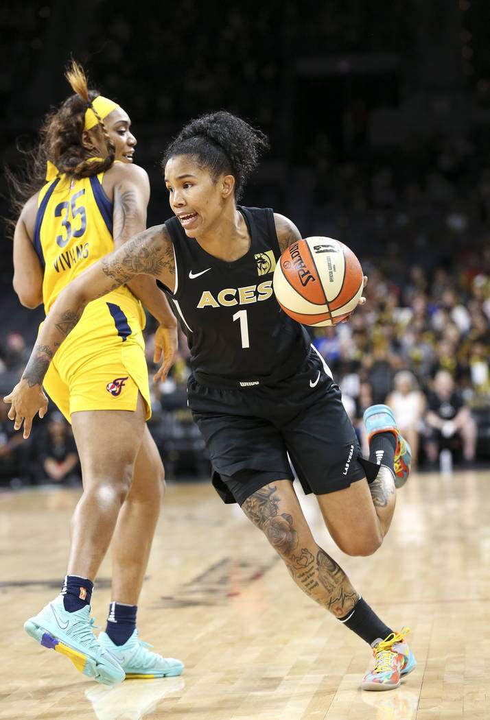 Las Vegas Aces forward Tamera Young (1) drives the ball past Indiana Fever guard Victoria Vivians (35) during the second half of a WNBA basketball game at the Mandalay Bay Events Center in Las Veg ...