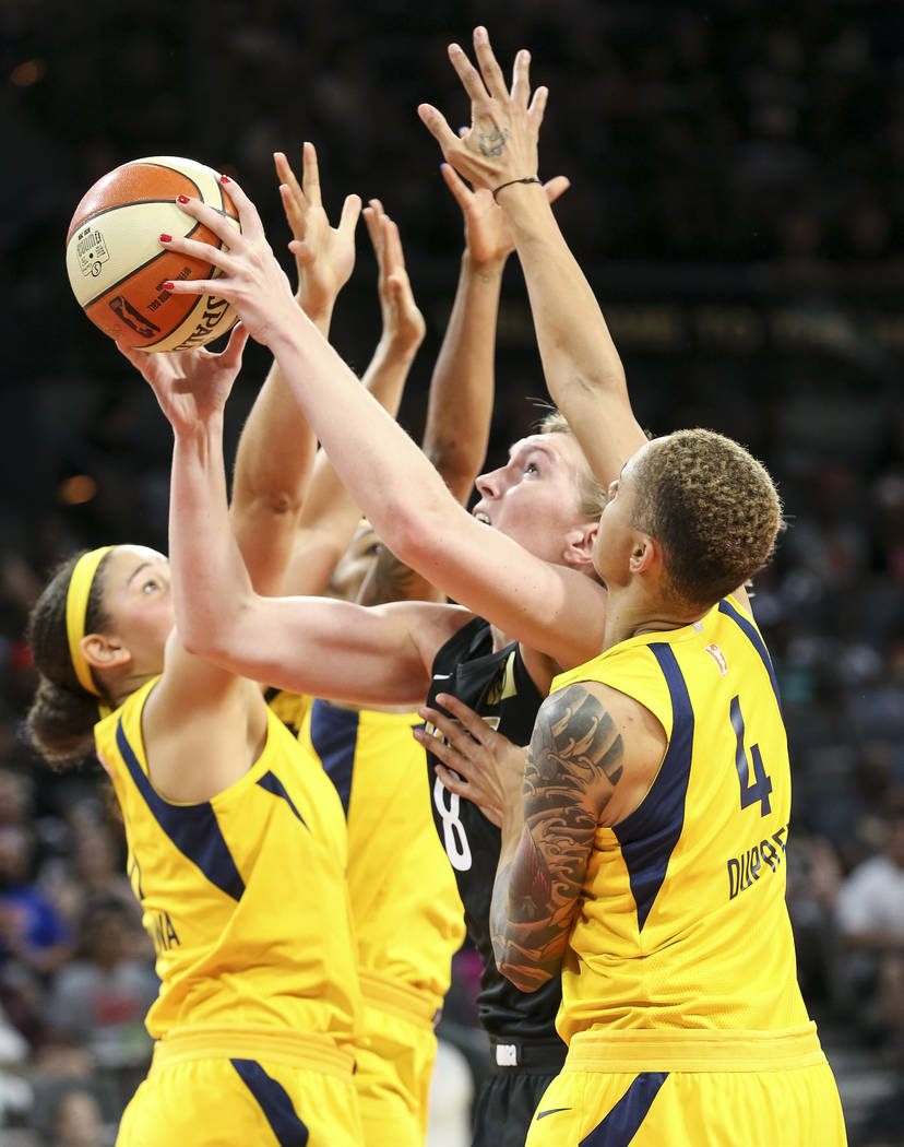 Las Vegas Aces center Carolyn Swords (8) goes up for a shot as she is swarmed by Indiana Fever defenders during the second half of a WNBA basketball game at the Mandalay Bay Events Center in Las V ...
