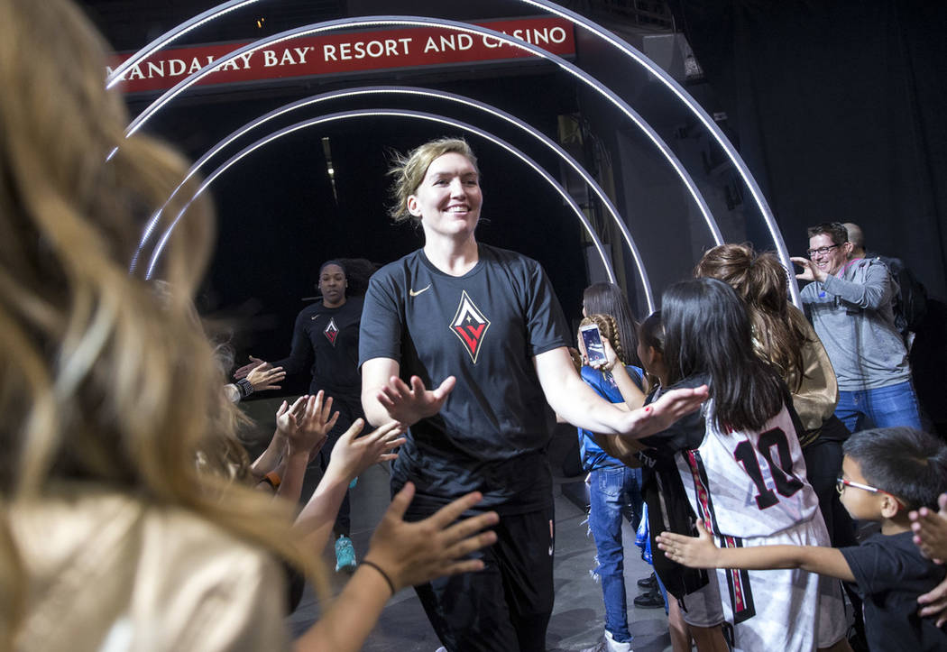 Las Vegas Aces center Carolyn Swords (8) is greeted by fans before playing the Seattle Storm in a WNBA basketball game at the Mandalay Bay Events Center in Las Vegas on Sunday, May 27, 2018. Richa ...