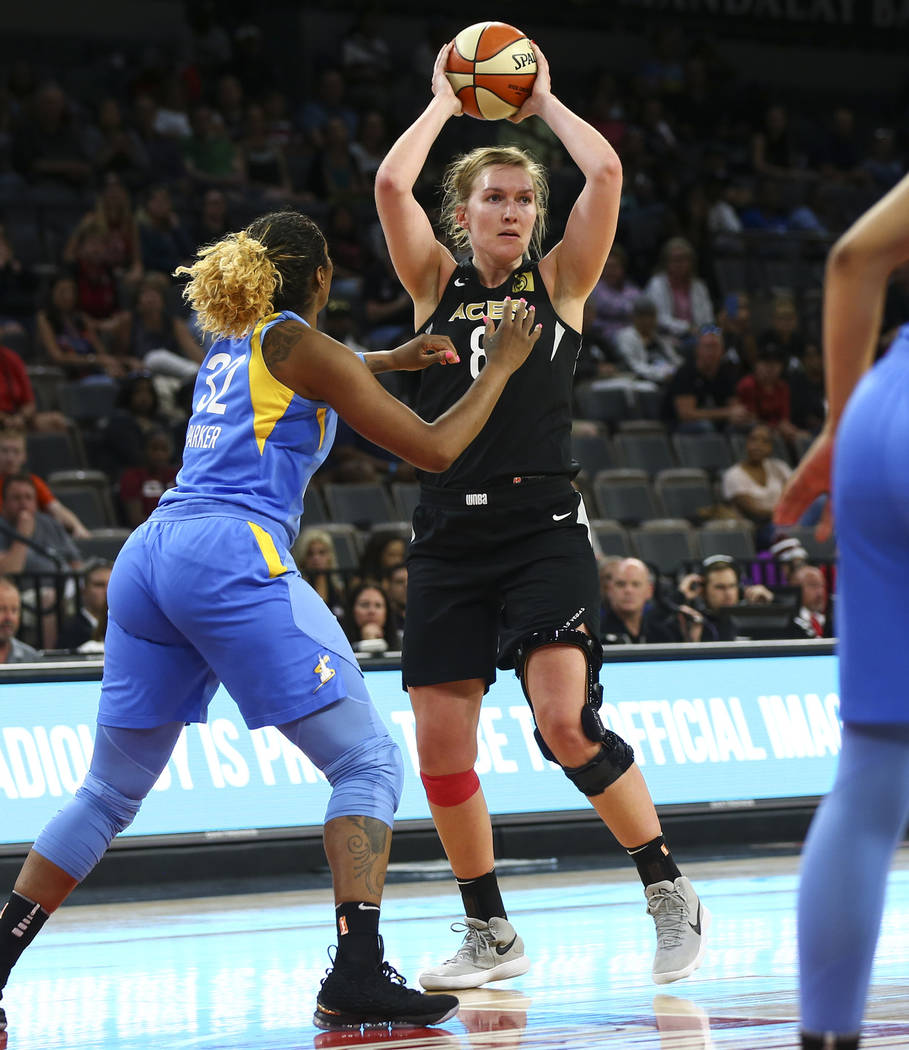 Las Vegas Aces center Carolyn Swords (8) looks to pass the ball in front of Chicago Sky forward Cheyenne Parker (32) during the second half of a WNBA basketball game at Mandalay Bay Events Center ...