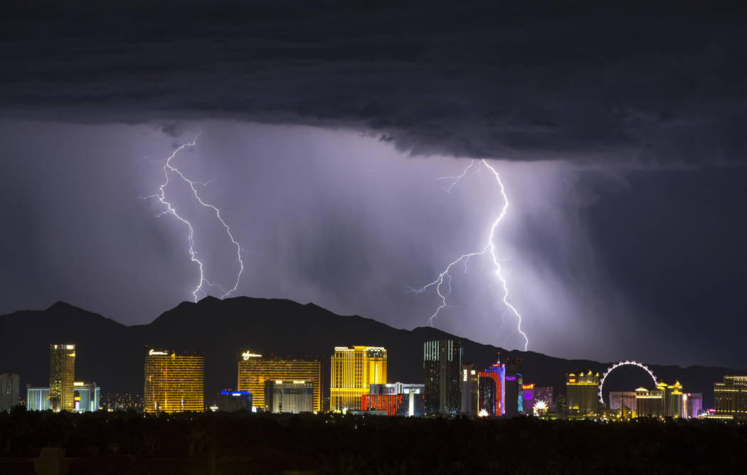 Lighting strikes in the distance during a storm in Las Vegas on Thursday, July 19, 2018. Richard Brian Las Vegas Review-Journal @vegasphotograph