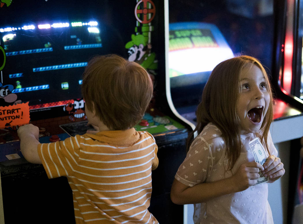 Matthew, 3, and Layla, 7, play arcade game at the Pinball Hall of Fame in Las Vegas, Sunday, July 22, 2018, before they move to Arkansas in a week due to their father's job.  M ...