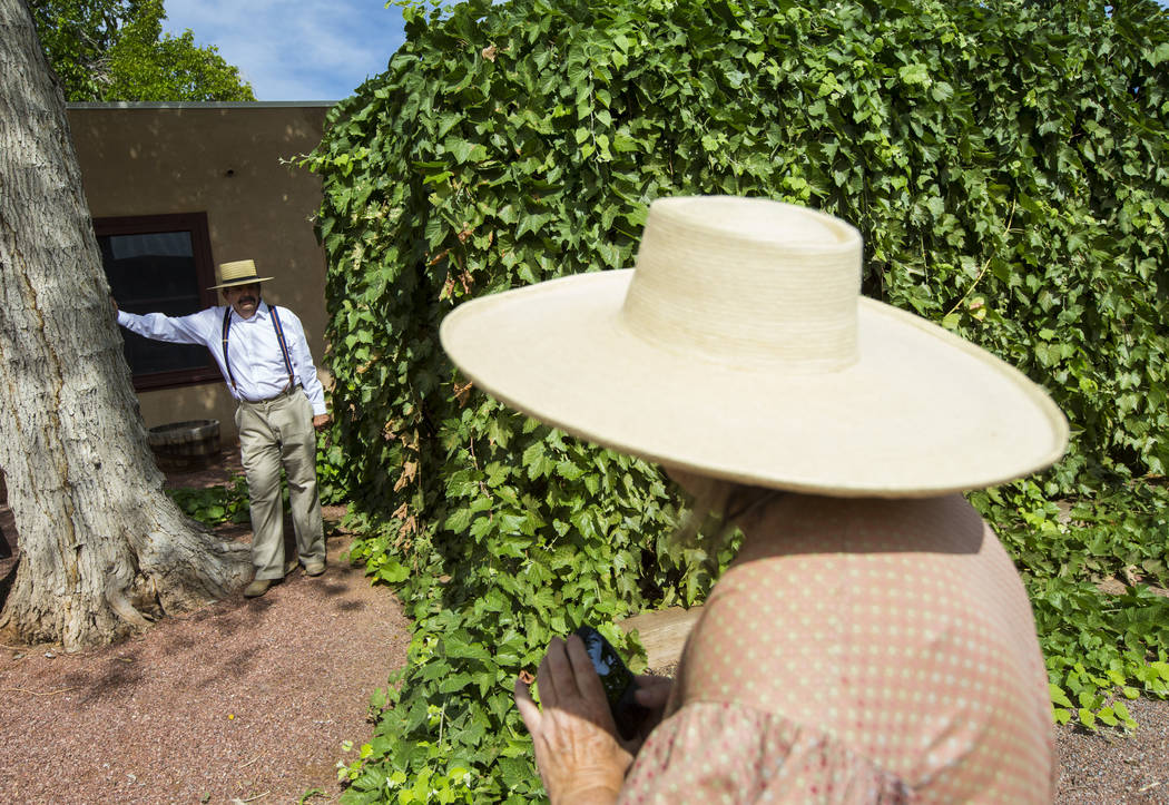 "Former Clark County Museum curator Dawna Jolliff, right, photographs husband Mike as the two attend the ""Pioneer Day"" event at the Old Las Vegas Mormon Fort State Historical Park in Las ..."