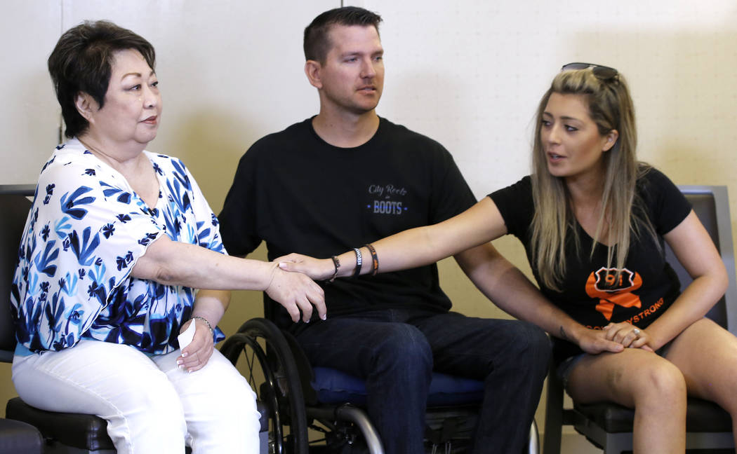 Joyce Shipp, left, who lost her daughter, Laura Shipp, from gunfire in the Oct, 1, 2017, Las Vegas shooting, gets support from Fiorella Gaeta, right, and her fiance, Jason McMillan, center, who is ...