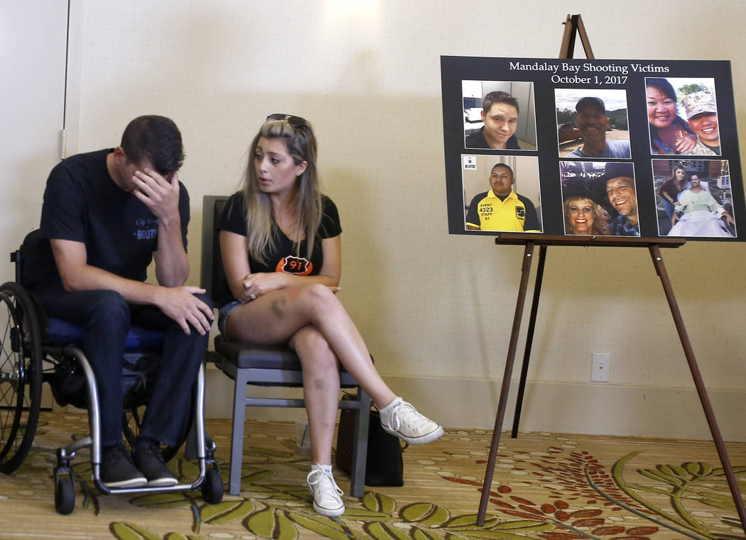 Fiorella Gaeta consoles her fiance, Jason McMillan, 36, of Riverside, a Riverside County Sheriff's deputy who was shot and paralyzed in the Oct, 1, 2017, Las Vegas shooting, reacts after he talks ...