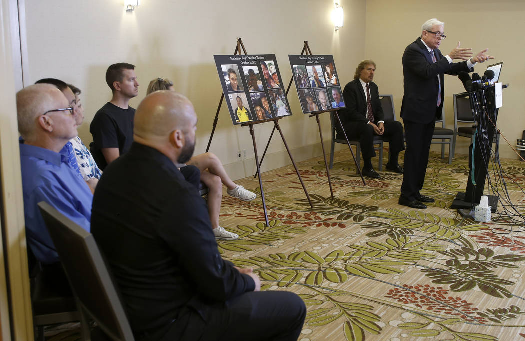 Attorney Mark P. Robinson, right, representing shooting victims and family members who lost loved ones in the Oct. 1, 2017, Las Vegas shooting, talks about MGM's decision, at a news conference in ...