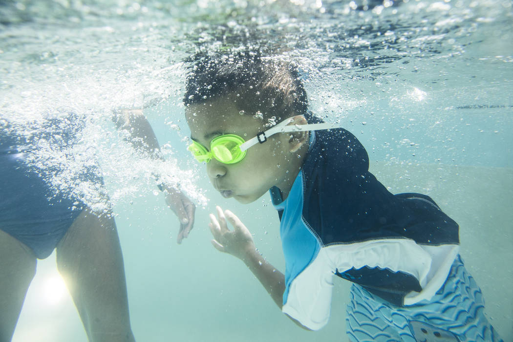 Justin Jachai, 7, practices his stroke during swim class at the Hollywood Aquatic Center on Monday, July 23, 2018, in Las Vegas. Benjamin Hager Las Vegas Review-Journal @benjaminhphoto