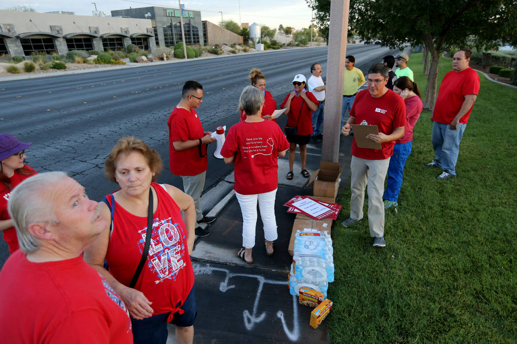 Nurses affiliated with the Nevada chapter of the national Nurses Organizing Committee prepare to protest outside MountainView Hospital in Las Vegas Tuesday, July 24, 2018, to address what they say ...