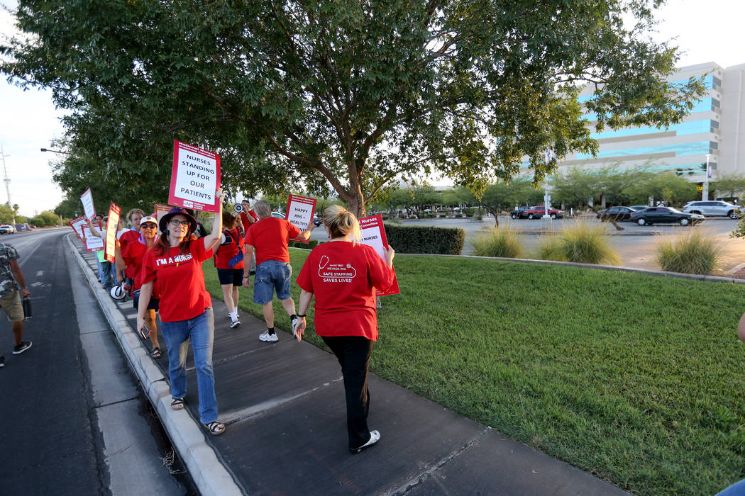 Nurses and supporters affiliated with the Nevada chapter of the national Nurses Organizing Committee protest outside MountainView Hospital in Las Vegas Tuesday, July 24, 2018, to address what they ...