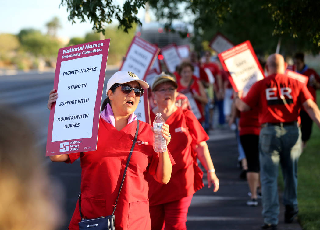 Nurses and supporters affiliated with the Nevada chapter of the national Nurses Organizing Committee, including Toni Stockman, left, protest outside MountainView Hospital in Las Vegas Tuesday, Jul ...