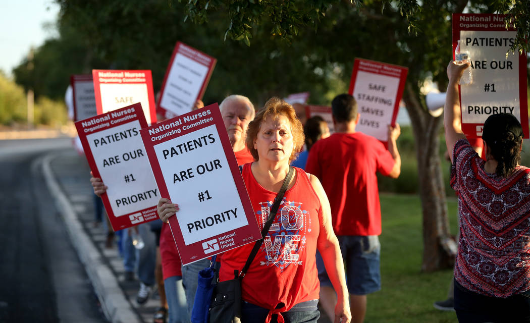 Nurses and supporters affiliated with the Nevada chapter of the national Nurses Organizing Committee, including Dolly Covert, front, protest outside MountainView Hospital in Las Vegas Tuesday, Jul ...