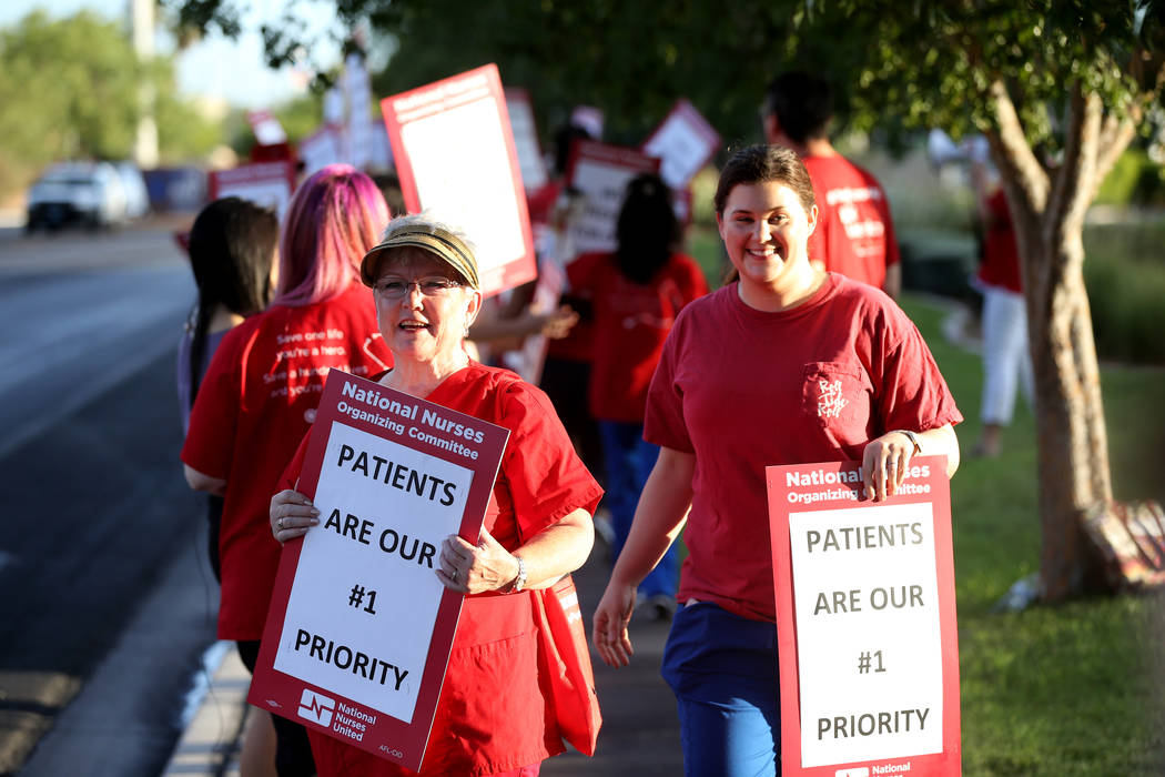 Nurses and supporters affiliated with the Nevada chapter of the national Nurses Organizing Committee, including Chris Garth, front, protest outside MountainView Hospital in Las Vegas Tuesday, July ...
