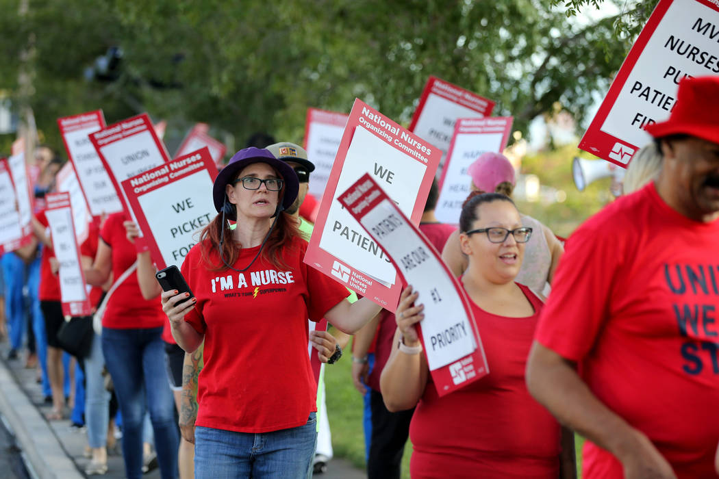 Nurses and supporters affiliated with the Nevada chapter of the national Nurses Organizing Committee, including Mary Ann Nocie, left, protest outside MountainView Hospital in Las Vegas Tuesday, Ju ...