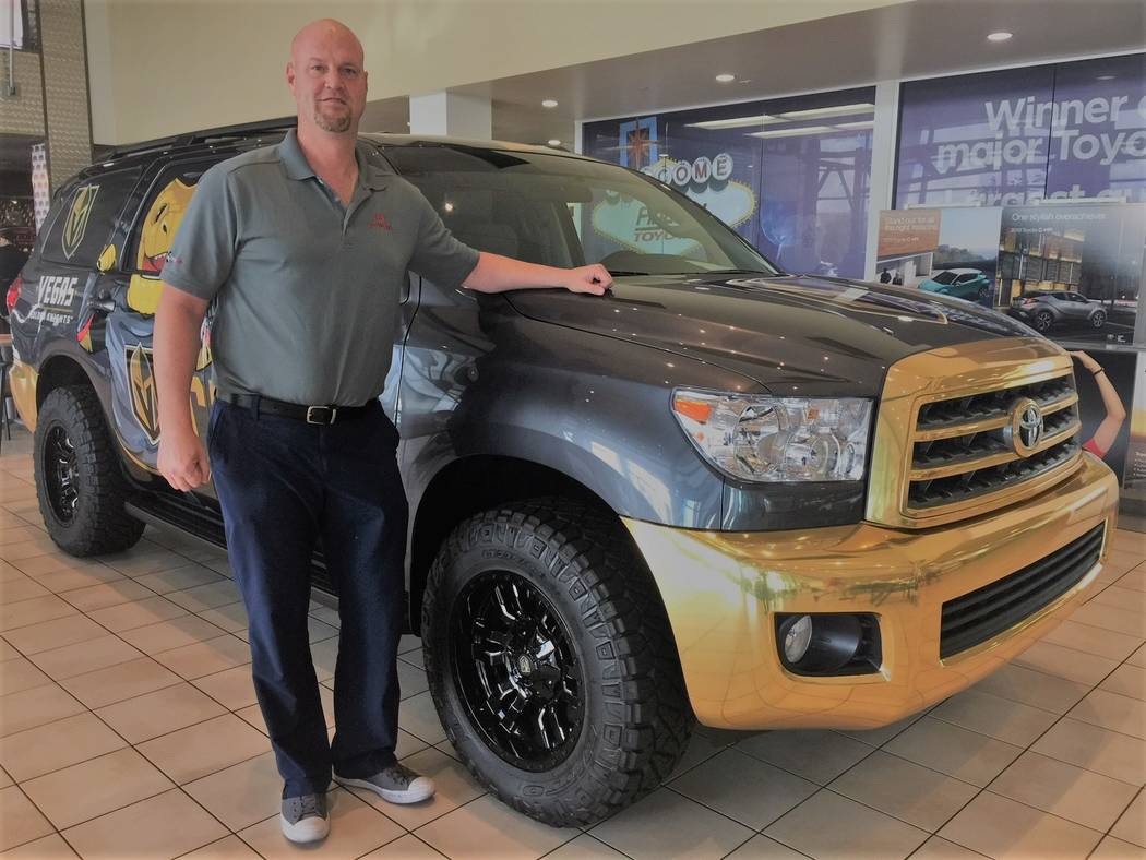 Findlay Toyota finance manager Eric Ludwick is seen with a 2018 Toyota Sequoia Vegas Golden Knights-themed sport utility vehicle at the dealership situated at 7733 Eastgate Road in the Valley Auto ...