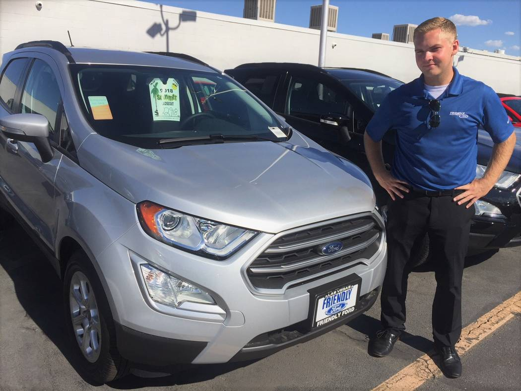 Friendly Ford sales consultant Isaac Roberts is seen with the 2018 Ford EcoSport at the dealership located at 660 N. Decatur Blvd. (Friendly Ford)