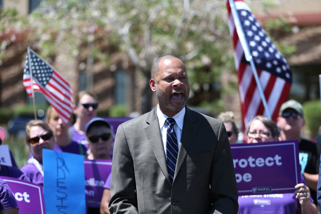 Senate Majority Leader Aaron Ford speaks during a rally hosted by the Nevada Democrats and NARAL to protest the Supreme Court pick outside of the office building of U.S. Sen. Dean Heller, R-Nev., ...
