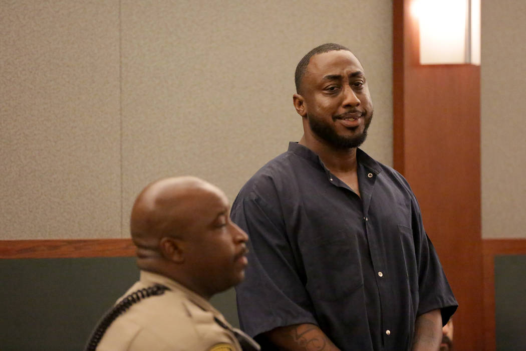 Ocean Fleming, the convicted pimp serving life in prison, looks to family members after a new sentencing hearing on Tuesday, July 24, 2018 at the Regional Justice Center. Michael Quine Las Vegas R ...