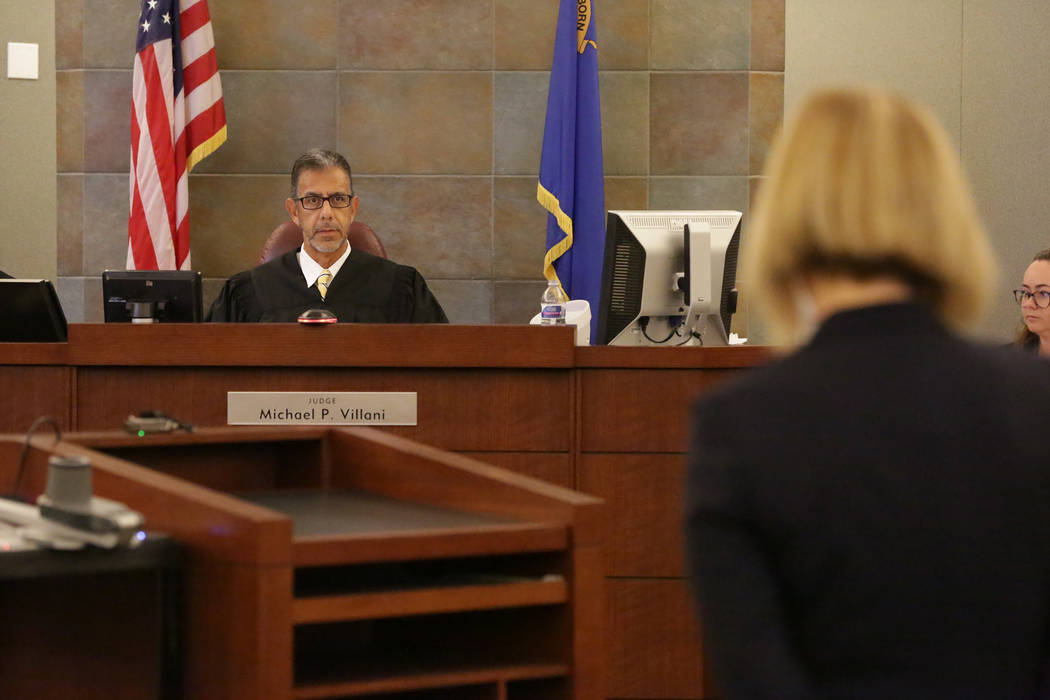 Judge Michael P. Villani listens to arguments from defense attorney Janiece Marshall during a new sentencing hearing for Ocean Fleming, the convicted pimp currently serving life in prison, at the ...