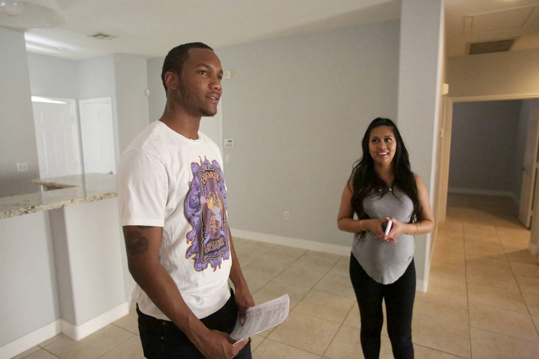 After a quick walkthrough, Darrius Mathis, left, and Kayte Fernandez discuss the details of a rental home with their real estate in Summerlin on Friday, July 20, 2018. Michael Quine Las Vegas Revi ...