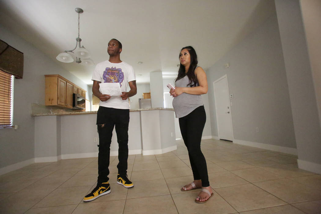 After a quick walkthrough, Darrius Mathis, left, and Kayte Fernandez listen to the details for a rental home in Summerlin on Friday, July 20, 2018. Michael Quine Las Vegas Review-Journal @Vegas88s