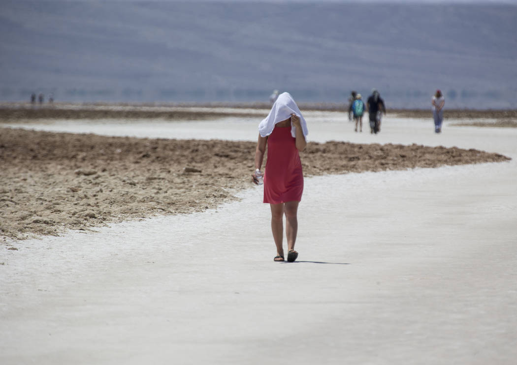 Diana Senci of the Netherlands visits Badwater Basin, 282 feet below sea level, in Death Valley National Park, Calif., Thursday, July 26, 2018. Richard Brian Las Vegas Review-Journal @vegasphotograph