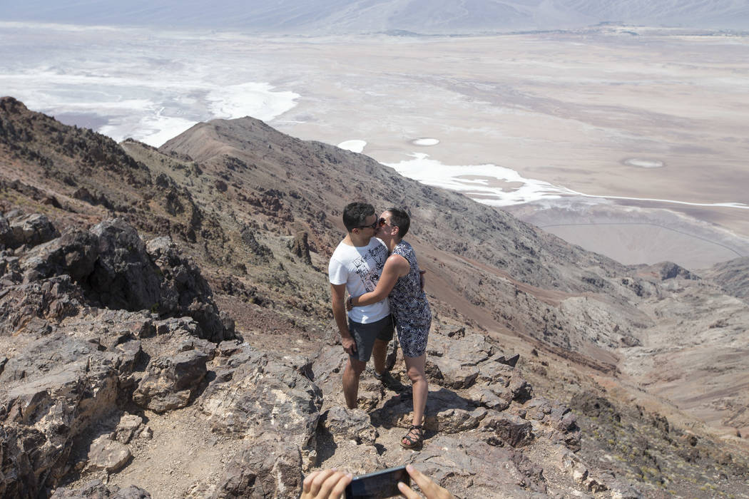 Cecile and Sebastien Abin of France share a kiss at Dante's View, a popular lookout point in Death Valley National Park, Calif., Thursday, July 26, 2018. Richard Brian Las Vegas Review-Journal @ve ...