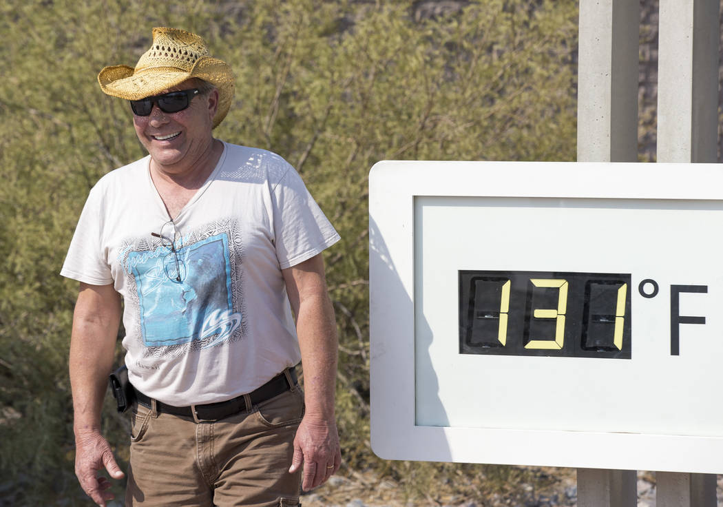 Rich Salvatore of Las Vegas poses at the Furnace Creek Visitor Center thermometer in Death Valley National Park, Calif., Thursday, July 26, 2018. The official temperature at the park rose to 127 o ...