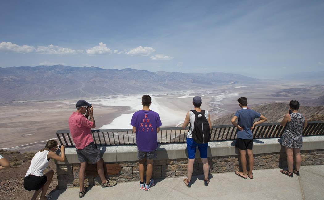 Visitors take in the scenery at Dante's View, a popular lookout point in Death Valley National Park, Calif., Thursday, July 26, 2018. Richard Brian Las Vegas Review-Journal @vegasphotograph