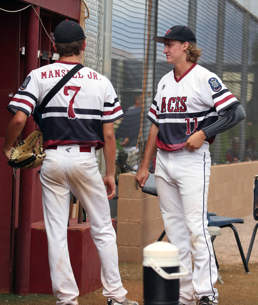 Desert Oasis' Josh Sharman, right, and Dustin Mansell Jr. chat in the dugout during a game against Silverado High at Desert Oasis High School on Friday, July 13, 2018, in Las Vegas. Bizuayehu Tesf ...