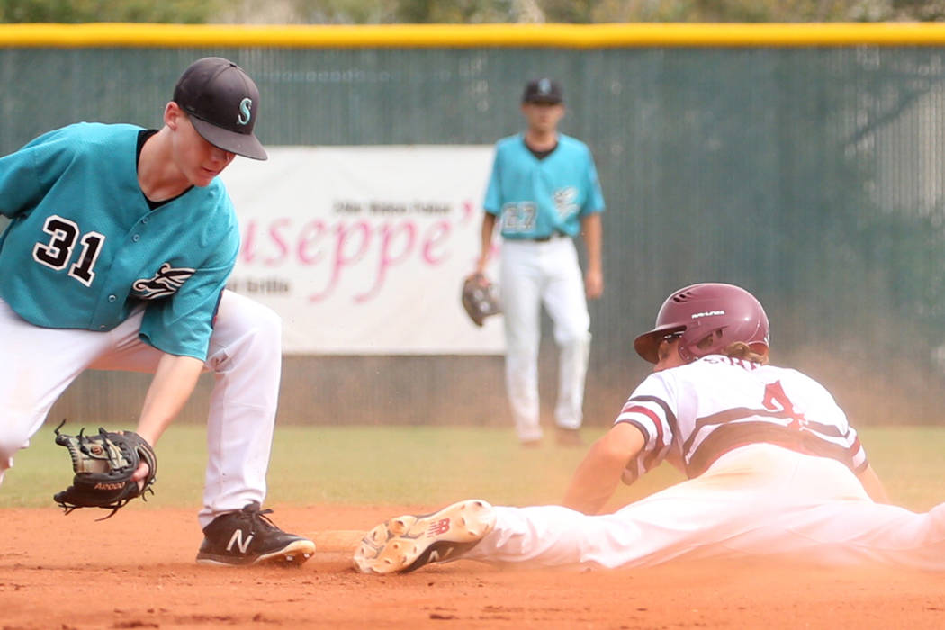 Desert Oasis' centerfielder Parker Schmidt lands safe at second as Silverado High's Jared Hill attempts to tag during a game at Desert Oasis High School on Friday, July 13, 2018, in Las Vegas. Biz ...