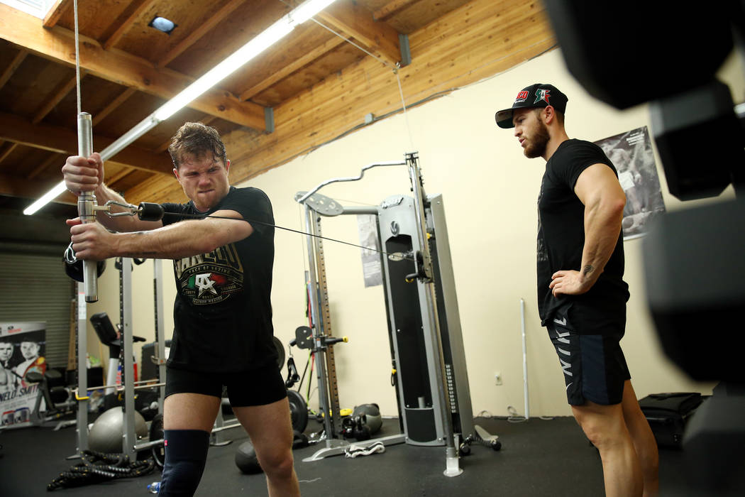 "Boxer Saul ""Canelo"" Alvarez, left, works with his trainer Raul Arreola at his gym in San Diego, Calif., Friday, July 27, 2018. Erik Verduzco Las Vegas Review-Journal @Erik_Verduzco"