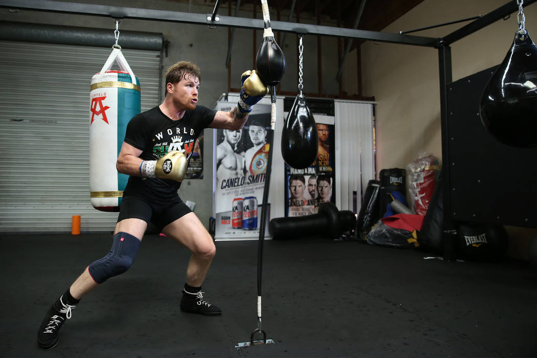 "Boxer Saul ""Canelo"" Alvarez, right, works out at his gym in San Diego, Calif., Friday, July 27, 2018. Erik Verduzco Las Vegas Review-Journal @Erik_Verduzco"